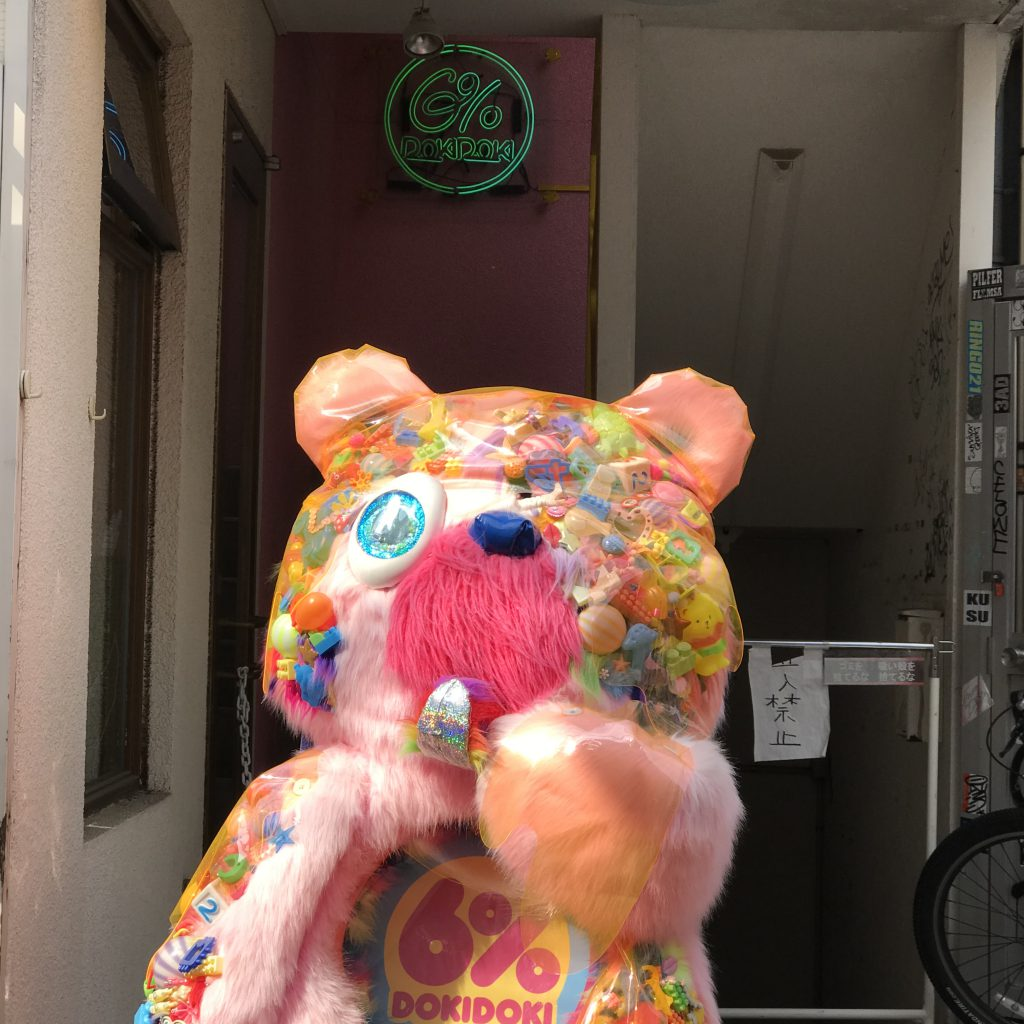 Large Pink Bear stands in front of stair to 6% DOKIDOKI, Harajuku, Tokyo